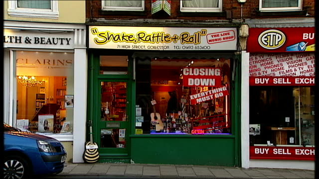 Great Yarmouth / Boston / Grimsby ENGLAND Norfolk Great Yarmouth INT Guitar being played / Guitars hanging in music shop / 'Shake Rattle and Roll'...