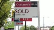 General views estate agents Sold Let and For Sale signs stand along a street in Kingston UK on Monday June 23 Pedestrians and traffic walk past...