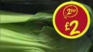 General views of ASDA supermarket in Leeds ENGLAND Yorkshire Leeds INT ASDA supermarket workers along fruit veg aisle chatting and looking at...