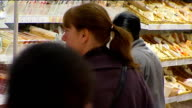 General views of Asda supermarket shoppers and produce ENGLAND London EXT Good general views of an Asda superkmarket showing close shots of reduced...