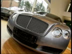 General views of Barvikha Luxury Village near Moscow INT Various of Bentley and Lamborghini cars in car showroom includes close ups of car interiors...