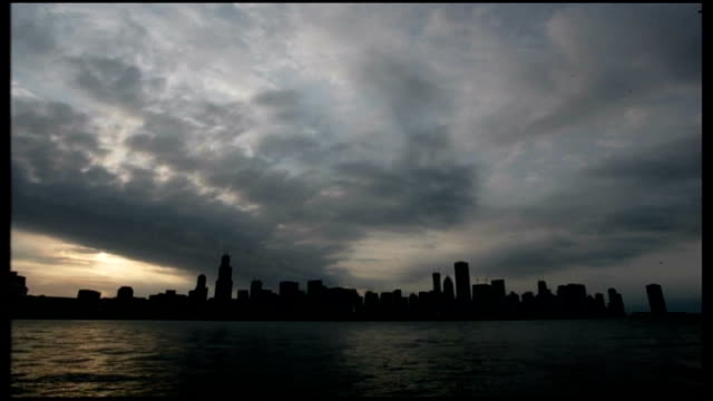 General views of Chicago NIGHT SEQ electrical storm with forked lightning over downtown buildings / SPEEDED UP TIME LAPSE SEQ traffic along busy...