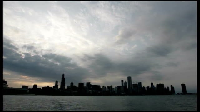 General views of Chicago NIGHT SEQ showing electrical storm with forked lightning over Chicago skyline SPEEDED UP TIME LAPSE SEQ clouds moving across...