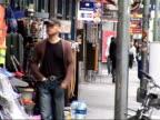 General views of Frankfurt Pedestrians along street in red light district/ Cafe next to strip club