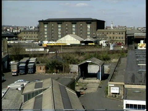 General views of Kings Cross in the late 1980s Close up sign 'Culross Buildings' on Battlebridge Road / traffic along Battlebridge Road / general...