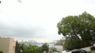 General views of luxury homes in Point Piper Sydney Australia on Tuesday Mar 10 Pan LR and RL of a brown house surrounded by trees Pull focus into...