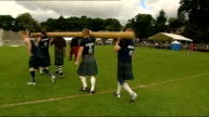 General views of Pitlochry Highland Games SCOTLAND Perthshire Pitlochry EXT **Music heard SOT** General views of bagpipers along playing bagpipes at...