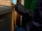 General views of police officers raiding houses Police officers leaving house / feet of police officers walking over broken door lock / police...