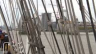 General views of tall ships on River Thames Close shots of ropes on tall ship / tall ship along on Thames and toots horn / GVs of 'Artemis' / anchor...