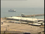 General views of the Port of Dover Close shot of ferry approaching Port of Dover PULL OUT to wide shot / Lorries / General views of Port of Dover /...