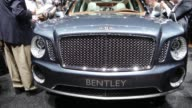 general views of the press taking photos and videos of the Bentley SUV / beauty shots of the SUV / signage 82nd Geneva International Motor Show Press...