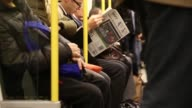 General views passengers onboard a Circle Line tube train on the London Underground network people reading newspapers and using their smartphones in...