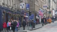 General views pedestrians and vehicles pass along the Royal Mile on the day of the Scottish Independence Referendum in the Old Town area of Edinburgh...