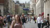 General views pedestrians walk through a cobbled square by Covent Garden Market in central London on Monday Aug 4 Pedestrians walk through stone...