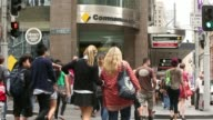General views pedestrians walk through Martin Place in the central business district of Sydney Australia on Monday Feb 10 Pedestrians walk past a...