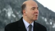 General views Pierre Moscovici France's finance minister during a Bloomberg Television interview on day three of the World Economic Forum in Davos...