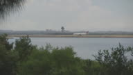 General views taken from The Grand Parade Brighton Le Sands wide shot of calm waters of Botany Bay industrial storage vats on Port Botany Headlands...