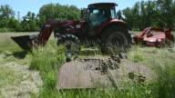 Generic farming, red tractor harvesting hay