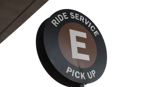 Generic footage of Ride Service Pick Up Area E sign on display at Los Angeles International Airport in Los Angeles California US on Monday November...