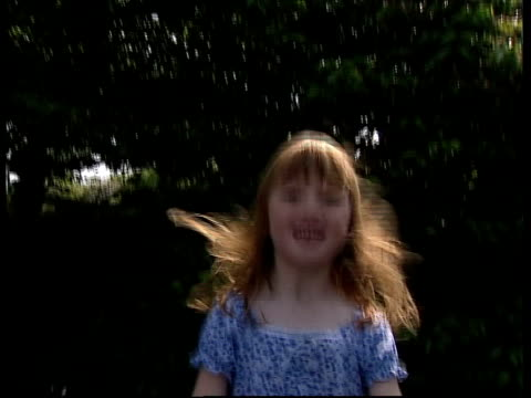New fundings/Safeguards ITN MS 6yearold Bronte Hardy who suffers from Cystic Fibrosis bouncing on trampoline in the garden of her home CMS Ditto CMS...