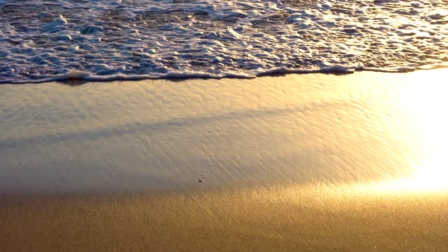 Gentle waves at golden beach