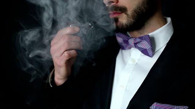 Gentleman smoking pipe