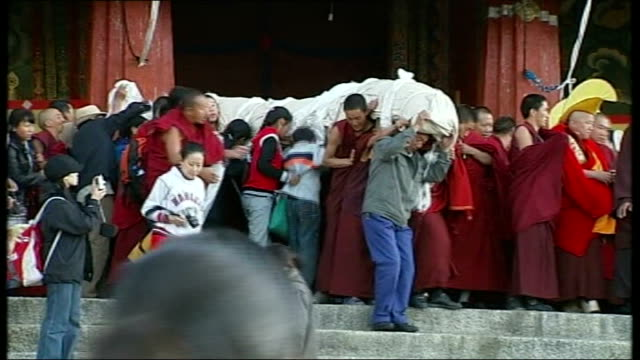 George Bush presents Dalai Lama with Congressional Gold Medal Tibet Lhasa Monks on rooftop of monastery blow huge traditional horns Giant image of...