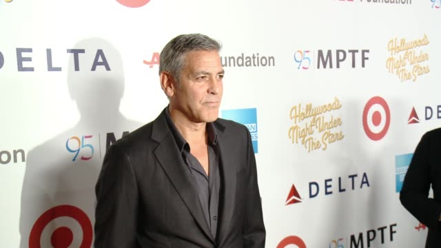 George Clooney Michael Douglas Hugh Jackman and Jim Gianopulos at the George Clooney Hosts MPTF's 95th Anniversary Celebration on October 1 2016 in...