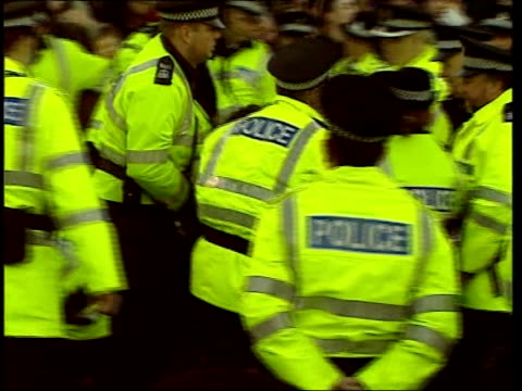 George Galloway arrested over Tridant protest ITN Faslane GVs Crowd protesting at Trident nuclear weapon submarines kept at Faslane and police at...