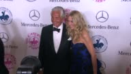 George Hamilton and Alana Stewart at The 2014 Carousel Of Hope Ball at The Beverly Hilton Hotel on October 11 2014 in Beverly Hills California
