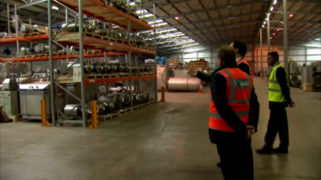 George Osborne business visit in Dumfries SCOTLAND Dumfries INT George Osborne MP along visiting factory / Osborne talking to worker / Osborne...