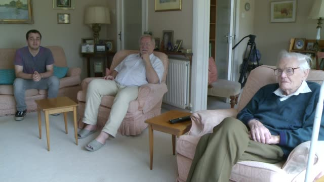 George Osborne delivers Autumn Statement 2015 LIB London INT Shots of Tom Clibbin Anthony Johnson and Tom's son Gerald Clibbing sitting in living room