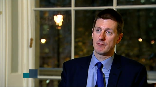 George Osborne delivers Autumn Statement ENGLAND London GIR INT Reporter to camera with video wall Robert Chote interview SOT Reporter to camera with...