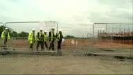 George Osborne laying bricks photocall ENGLAND Kent Ebbsfleet PHOTOGRAPHY *** Men laying bricks on construction site / George Osborne MP wearing hard...