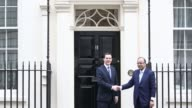 George Osborne UK chancellor of the exchequer left shakes hands with Arun Jaitley India's finance minister on the steps of 11 Downing Street ahead of...