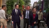 George Osborne visit aims to bridge Chinese economy with western financial markets LIB George Osborne and Lord O'Neill along with others in hutong