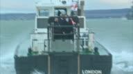 George Osborne visits to Portsmouth Naval Base ENGLAND Hampshire Portsmouth Her Majesty's Naval Base EXT George Osborne MP on board a boat / Osborne...