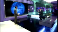 George Osborne warned by IMF to prepare for further economic decline GIR Reporter to camera at video wall