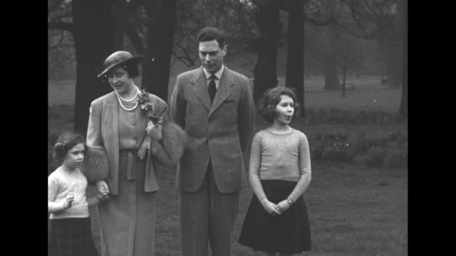 George VI Queen Elizabeth and Princesses Elizabeth and Margaret pose at Sandringham Estate