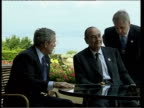 George W Bush and Jacques Chirac onto hotel verandah and sit for photocall George W Bush speaking to press SOT we went thru a difficult period I...