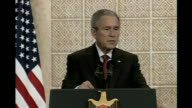 George W Bush calls for end of 'Israeli occupation' of West Bank VIA EBU Bush and Abbas at podiums in press conference Bush press conference SOT I...