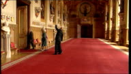 day 1 George W Bush and First Lady Laura meet Queen Elizabeth at Windsor Castle INT Queen Elizabeth Prince Philip Bush Laura towards in St George's...