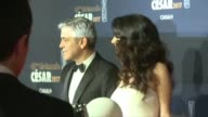 Georges Clooney and his pregnant wife Amal Alamuddin walk the red carpet together in Paris at the Cesar Awards ceremony the most prestigious awards...