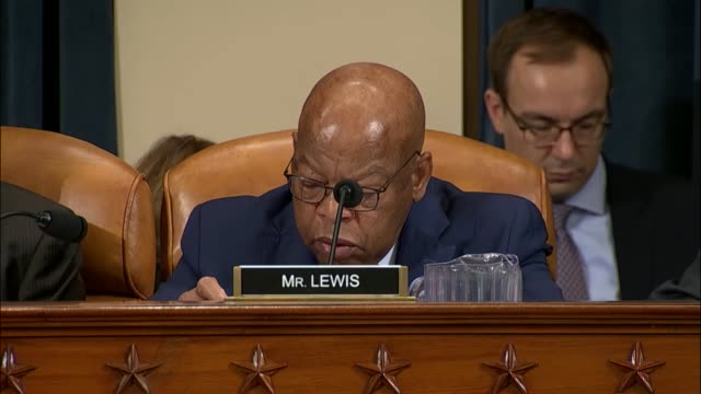 Georgia Congressman John Lewis argues for his amendment on the third day of a House Ways and Means Committee markup on tax reform to stop the repeal...
