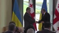 Georgian President Giorgi Margvelashvili welcomes his Ukrainian counterpart Petro Poroshenko with an official welcoming ceremony in Tbilisi on July...