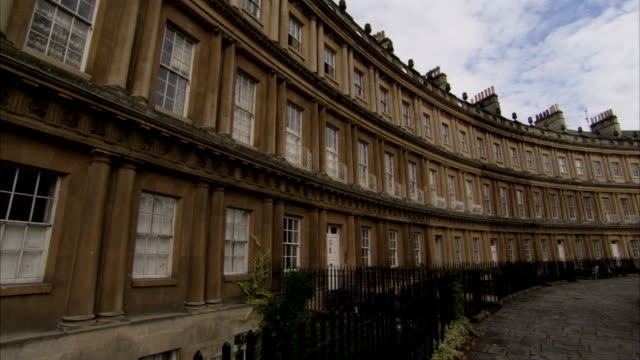 Georgian townhouses form part of the curving facade of The Circus, Bath. Available in HD.