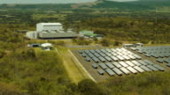A Geothermal power plant is seen next to a solar power park run by the Costa Rican Electricity Institute