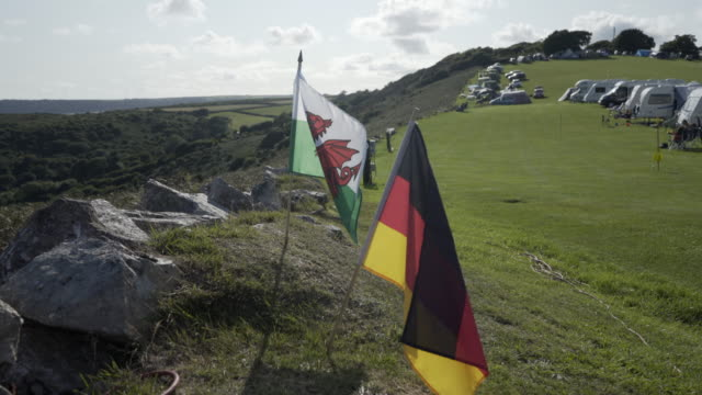 German and Welsh Flags together blowing in the wind.