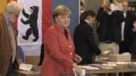 German Chancellor and leader of the Christian Democratic Union party Angela Merkel and her husband Joachim Sauer cast their ballots for the federal...