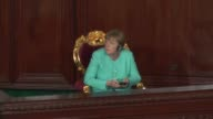 German Chancellor Angela Merkel accompanied with Tunisian parliamentary speaker Mohamed alNasser attends a meeting at the Tunisian parliament during...
